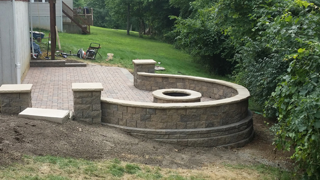 Seating Wall and fire pit in a backyard in Florence, Kentucky.