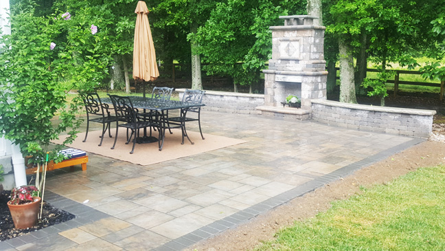 Paver patio and columns in a backyard in Colerain, Ohio.