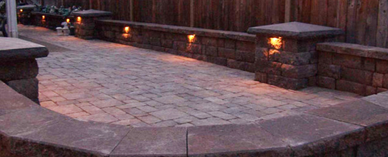 Outdoor lighting on a back yard at dusk.
